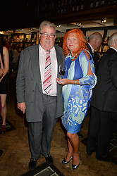 SIR WILLIAM & LADY McALPINE at a party to celebrate the publication of Stanley I Resume by Stanley Johnson at the Daunt Bookshop, Marylebone High Street, London on 23rd September 2014.