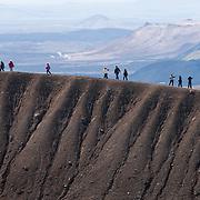 Tourists walking the rim of the Viti crater, Krafla, Iceland