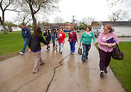 Trinity Renchin (back towards camera), student ambassador, leads a tour of prospective students and their parents during an open house at Waldorf College in Forest City, Iowa on Saturday, May 14, 2011.