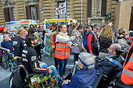 Roma 4 Novembre  2014.<br /> Manifestazione davanti al ministero dell'Economia del Comitato 16 Novembre, associazione di persone malate di Sla e loro famigliari, per chiedere il ripristino del fondo della non autosufficienza  ridotto a 250 milioni con la legge di Stabilità, non solo torni a 350 milioni ma venga aumentato a un miliardo. Un infermiera comunica con un ammalato di Sla con la Tavola di Comunicazione.<br /> Rome November 4, 2014. <br /> Demonstration in front of the Ministry of Economy Committee November 16, an association of people sick  with ALS and their families, to ask for the restoration fund of self-sufficiency reduced to 250 million by the law of stability, not only back to 350 million but is increased one billion. A nurse  communicates with a patient with ALS with the Table of Communication