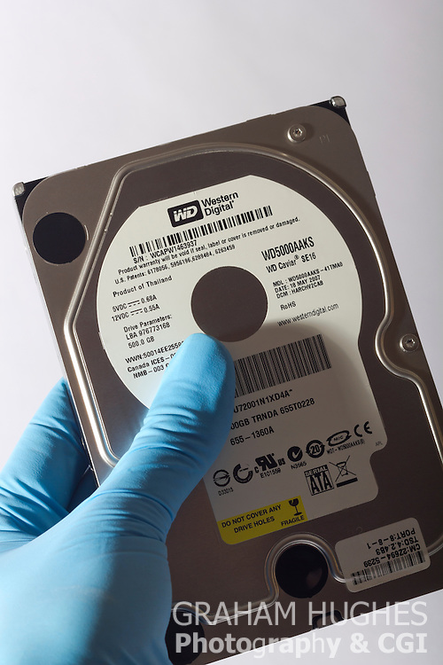 Computer Hard Drive With Gloved Hand