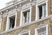 UNITED KINGDOM, London: 06 March 2018 Windows of the Mayflower Hotel in Earls Court, London are left open this afternoon after a Spanish tourist was found dead and a friend was found critically ill in their hotel room. It has been reported that a high level of gas was found in their room. Rick Findler / Story Picture Agency