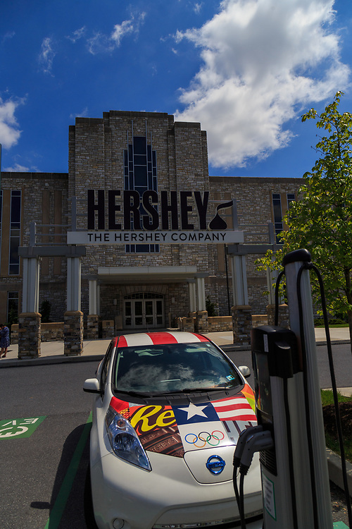 Hershey, PA, USA - May 21, 2018: Energy efficient green electric cars parked at the Hershey Company Chocolate factory in downtown Hershey.