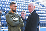 Kemar Roofe of Leeds United (7) and Leeds United legend Eddie Gray chat after arriving at the ground during the EFL Sky Bet Championship match between Preston North End and Leeds United at Deepdale, Preston, England on 9 April 2019.