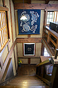 Photo shows the stairwell inside the Folk Art Museum, which is located in the Toyama Folk Village in Toyama Prefecture Japan. The storehouse, which once housed a bath house for servants, was built in 1879 and moved to its current location in 1965.