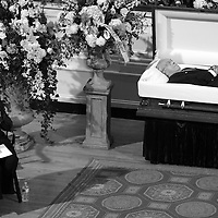 Angela Menino sits near the casket of her husband, former Boston Mayor Thomas M. Menino, as he lies in state at Faneuil Hall, Sunday, November 02, 2014.