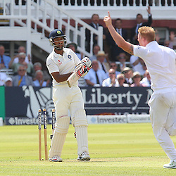 England's Ben Stokes gets the wicket of India's Cheteshwar Pujara out for 28 during the first day of the Investec 2nd Test match between England and India at Lords, London, 17th July 2014 © Phil Duncan | SportPix.org.uk
