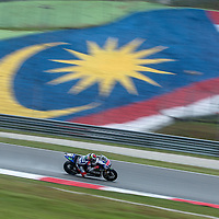 Spanish MotoGP rider Jorge Lorenzo of Movistar Yamaha MotoGP speeds on a wet track during the practice session of the 2014 Malaysian Motorcycling Grand Prix in Sepang International Circuit near Kuala Lumpur, Malaysia, 24 October 2014. The Malaysian Motorcycling Grand Prix will take place from 24 to 26 October 2013.