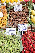 Medlars, strawberries, apricots with Turkish lira price tickets, food market in Kadikoy district Asian side of Istanbul, Turkey