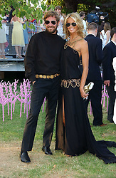 STEFANO PILATI and ELLE MACPHERSON at the Serpentine Gallery Summer party sponsored by Yves Saint Laurent held at the Serpentine Gallery, Kensington Gardens, London W2 on 11th July 2006.<br />