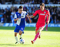 Bristol Rovers' Jake Gosling is challenged by Dover Athletic's Tom Bonner - Photo mandatory by-line: Neil Brookman - Mobile: 07966 386802 - 04/10/2014 - SPORT - Football - Bristol - Memorial Stadium - Bristol Rovers v Dover - Vanarama Football Conference