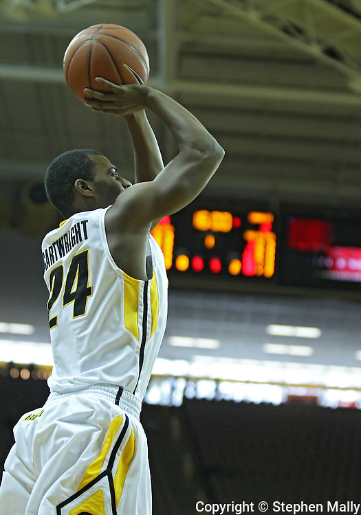 December 04 2010: Iowa Hawkeyes guard Bryce Cartwright (24) puts up a shot during the first half of their NCAA basketball game at Carver-Hawkeye Arena in Iowa City, Iowa on December 4, 2010. Iowa won 70-53.