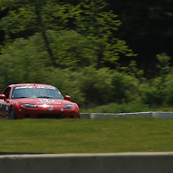 May 23, 2009; Lakeville, CT, USA; The Flatout Motorsports Mazda MX-5 qualifies for the Grand-Am Koni Sports Car Challenge series competition during the Memorial Day Road Racing Classic weekend at Lime Rock Park.