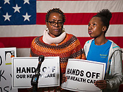 "31 OCTOBER 2019 - DES MOINES, IOWA: ROCHEAN WILDEN, left, looks at her daughter, DESHAAN WILDEN, 13, while talking about her need for affordable, comprehensive healthcare. Wilden said her daughter is autistic and they would lose their healthcare if a plan proposed by Republicans in the US Senate to eliminate coverage for pre-existing conditions passed. A small crowd of people came to the Neil Smith Federal Building, where US Senators Chuck Grassley's (R-IA) and Joni Ernst's (R-IA) offices are, to deliver a petition protesting the Senate's vote that critics say would allow ""spooky junk health insurance plans"" with limited coverage and would allow insurance companies to deny coverage to people with pre-existing conditions.             PHOTO BY JACK KURTZ"