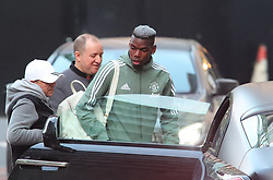 The Manchester United team arrive at The Lowry Hotel on Saturday evening to prepare for their home game against West Brom on Sunday afternoon. Seen: Paul Pogba was the last to arrive.