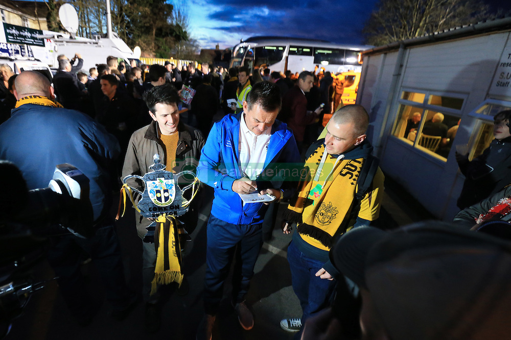 20 February 2017 - The FA Cup - (5th Round) - Sutton United v Arsenal - Paul Doswell manager of Sutton United sings a programme for a fan on his way to Gander Green Lane - Photo: Marc Atkins / Offside.