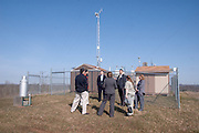 Gary Conley of The Voinovich School of Leadership and Public Affairs discusses the Air Quality Monitoring Station with Ohio official representatives.