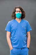 Male Nurse wearing scrubs and a face mask Male Nurse wearing scrubs and a face mask