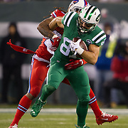 Nov 12, 2015; East Rutherford, NJ, USA; Buffalo Bills cornerback Stephon Gilmore (24) tackles New York Jets wide receiver Eric Decker (87) in the 1st quarter  at MetLife Stadium. Mandatory Credit: William Hauser-USA TODAY Sports