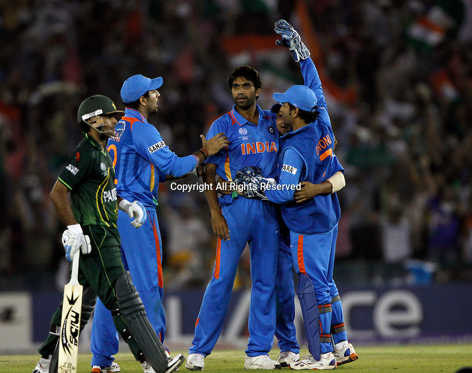 30.03.2011 Cricket World Cup from the Punjab Cricket Association Stadium, Mohali in Chandigarh. India v Pakistan.Munaf Patel celebrates the wicket of Mohammad Hafeez during the match of the ICC Cricket World Cup between India and Pakistan on the 30th March 2011