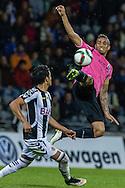 Portugal, FUNCHAL : Danilo, da equipa do F.C. do Porto disputa a bola durante o jogo da Liga Portuguesa de Futebol, Nacional vs F.C. Porto que teve lugar no Estádio da Madeira, Funchal  a 21 de Março de 2015.<br /> Foto-Gregório Cunha