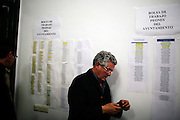 Workers lists are displayed at Espera Council, in Espera, Spain.