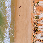 Aerial rocks and cliffs seascape shore view of famous Falesia beach, Algarve, Portugal.