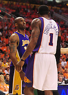May 29, 2010; Phoenix, AZ, USA; Los Angeles Lakers guard Kobe Bryant (24) reacts against Phoenix Suns forward Amare Stoudemire (1) during the second half in game six of the western conference finals in the 2010 NBA Playoffs at US Airways Center. The Lakers defeated the Suns 111-103. Mandatory Credit: Jennifer Stewart-US PRESSWIRE