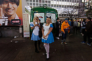 Two western women in Alice costumes during the Halloween celebrations Shibuya, Tokyo, Japan. Saturday October 27th 2018. The celebrations marking this event have grown in popularity in Japan recently. Enjoyed mostly by young adults who like to dress up, drink , dance and misbehave in parts of Tokyo like Shibuya and Roppongi. There has been a push back from Japanese society and the police to try to limit the bad behaviour.