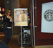 "**EXCLUSIVE**.Carmen Electra buys a frapuccino at Starbucks located at the American Airlines Terminal at LAX Airport before boarding a plane to JFK. She is in New York to do some press for her new movie ""Epic Movie"". She wanted to make sure she was OK with PETA so she told our photographer. ""The fur in my jacket is faux, touch it."".LAX and JFK Airport.Los Angeles, CA, USA .Saturday, January 20, 2007.Photo By Celebrityvibe.com.To license this image call (212) 410 5354 or;.Email: celebrityvibe@gmail.com; .Website: http://www.celebrityvibe.com/."