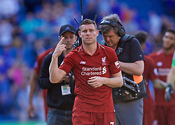 CARDIFF, WALES - Saturday, April 20, 2019: Liverpool's goal-scorer captain James Milner celebrates after the 2-0 victory during the FA Premier League match between Cardiff City FC and Liverpool FC at the Cardiff City Stadium. (Pic by David Rawcliffe/Propaganda)