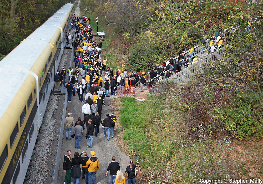 October 23 2010: Iowa fans walk up the stairs from the Hawkeye Express to Kinnick Stadium Before the start of the NCAA football game between the Wisconsin Badgers and the Iowa Hawkeyes at Kinnick Stadium in Iowa City, Iowa on Saturday October 23, 2010. Wisconsin defeated Iowa 31-30.