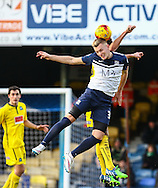 Ben Coker of Southend and Tom Flanagan of Plymouth Argyle, currently on load from MK Dons (rear) in an aerial battle during the Sky Bet League 2 match at Roots Hall, Southend<br /> Picture by David Horn/Focus Images Ltd +44 7545 970036<br /> 10/01/2015