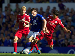 LIVERPOOL, ENGLAND - Saturday, October 1, 2011: Liverpool's Luis Alberto Suarez Diaz is tackled by Everton's Seamus Coleman during the Premiership match at Goodison Park. (Pic by Vegard Grott/Propaganda)