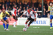 Woking midfielder Anthony Edgar (19) with the ball in midfield during the The FA Cup match between Woking and Accrington Stanley at the Kingfield Stadium, Woking, United Kingdom on 4 December 2016. Photo by David Charbit.