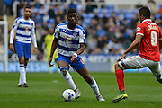 Reading's Aaron Tshibola looks for the forward pass during the Sky Bet Championship match between Reading and Charlton Athletic at the Madejski Stadium, Reading, England on 17 October 2015. Photo by Mark Davies.