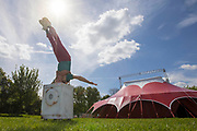 UNITED KINGDOM, London: 3 May 2018 A member of Britains leading circus company Lost in Translation performs in front of their pop up circus tent in Shillington Park in Wandsworth. The performance marks the start of the Wandsworth Arts Fringe and the opening of Battersea Circus Gardens which runs from May 4 - May 20 2018. Rick Findler / Story Picture Agency