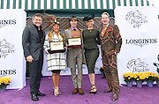 Longines fashion contest judges Robert Herjavec, left, of Shark Tank, Kym Johnson, second right, of Dancing with the Stars, and celebrity stylist Carson Kressley, right, pose with Longines Prize of Elegance winners Sarah Berkowitz, center left, of Nicholasville, KY and Kirk Hoefling, of Midway, KY, at the 2015 Breeders' Cup at Keeneland Racecourse on Saturday, Oct. 31, 2015 in Lexington, KY.  Longines, the Swiss watch manufacturer known for its elegant timepieces, is the Official Watch and Timekeeper of the Breeders' Cup World Championships and the Triple Crown. (Photo by Diane Bondareff/Invsion for Longines/AP Images)