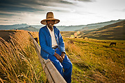 There are few things as dreamy as the ampitheatre in the nothern Drakensberg on a beautiful afternoon. This friendly cattle herder seemed content to enjoy the view, watch his cattle and sit for a portrait. Travel Photography by Chris Allan of Chris Allan Photo