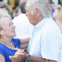 Vickie Barr, left, and William Barr dance to music by The Imitations during Lumina Daze Sunday August 24, 2014 at The Blockade Runner in Wrightsville Beach, N.C. (Jason A. Frizzelle)