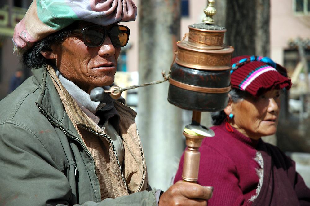 Buddhists praying outside the Bakong Monastery in Dege - taken March 20, 2008 - Michael Benanav - 505-579-4046