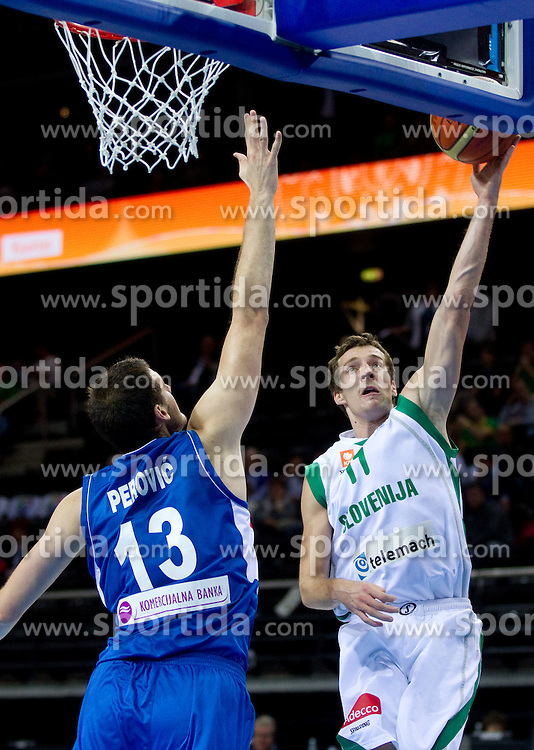 Kosta Perovic of Serbia vs Goran Dragic of Slovenia during basketball game between National basketball teams of Slovenia and Serbia in 7th place game of FIBA Europe Eurobasket Lithuania 2011, on September 17, 2011, in Arena Zalgirio, Kaunas, Lithuania. Slovenia defeated Serbia 72 - 68 and placed 7th. (Photo by Vid Ponikvar / Sportida)