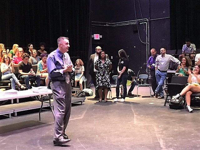 HSPVA senior and theater major Jorge Cordova on his last first day of school. Principal Scott Allen speaks to theater students before first period.