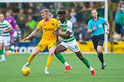 Robbie Crawford (#16) of Livingston FC shields the ball from Vakoun Issouf Bayo (#10) of Celtic FC during the Ladbrokes Scottish Premiership match between Livingston FC and Celtic FC at The Tony Macaroni Arena, Livingston, Scotland on 6 October 2019.