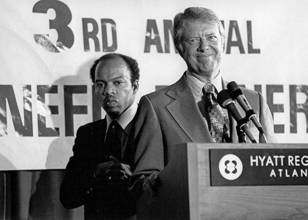 """President Jimmy Carter at an Atlanta civil rights conference in 1977 with John Lewis, a former top lieutenant to Dr. Martin Luther King, Jr. who would later be elected to the U.S. Congress.<br /> John Robert Lewis - born February 21, 1940 - is an American politician and civil rights leader. He is the U.S. Representative for Georgia's 5th congressional district, serving since 1987, and is the dean of the Georgia congressional delegation. The district includes the northern three-quarters of Atlanta.<br /> <br /> Lewis is the only living """"Big Six"""" leader of the American Civil Rights Movement, having been the chairman of the Student Nonviolent Coordinating Committee (SNCC), playing a key role in the struggle to end legalized racial discrimination and segregation. A member of the Democratic Party, Lewis is a member of the Democratic leadership of the House of Representatives and has served in the Whip organization since shortly after his first election to the U.S. Congress."""