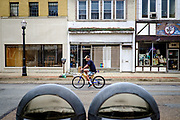 A man bicycles down the main shopping street in New Kensington, Pa. <br /> <br /> The city's downtown has declined since the 1970's after the main industry, aluminum production by Alcoa, closed down operations the 1960s. There are very few businesses in operation today.