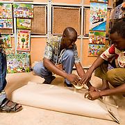 Vendors wrap an item that was just bought by a customer at the 22nd Salon International de l'Artisanat de Ouagadougou (SIAO) in Ouagadougou, Burkina Faso on Saturday November 1, 2008.