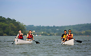 Students canoe on a nice summer day on Lake Mendota.  Rentals are available at Outdoor UW in Memorial Union, in 2014.