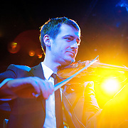 January 8, 2012 - Manhattan, NY : The Calder Quartet's  Benjamin Jacobson (violin) performs with Andrew W.K. (not pictured) at Le Poisson Rouge in Manhattan on Sunday evening.  CREDIT: Karsten Moran for The New York Times