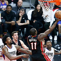 08 January 2017: Miami Heat guard Dion Waiters (11) goes for the layup past LA Clippers center DeAndre Jordan (6) and LA Clippers guard Jamal Crawford (11) during the LA Clippers 98-86 victory over the Miami Heat, at the Staples Center, Los Angeles, California, USA.